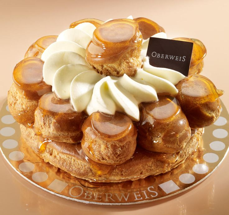 Saint Honoré, a famous French pastry made of profiteroles glued together with caramel sauce.