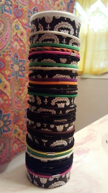 Upcycled ponytail holder, hair bow, and bobby pin storage using a Pringles can, scrapbooking paper, and Modge Podge.