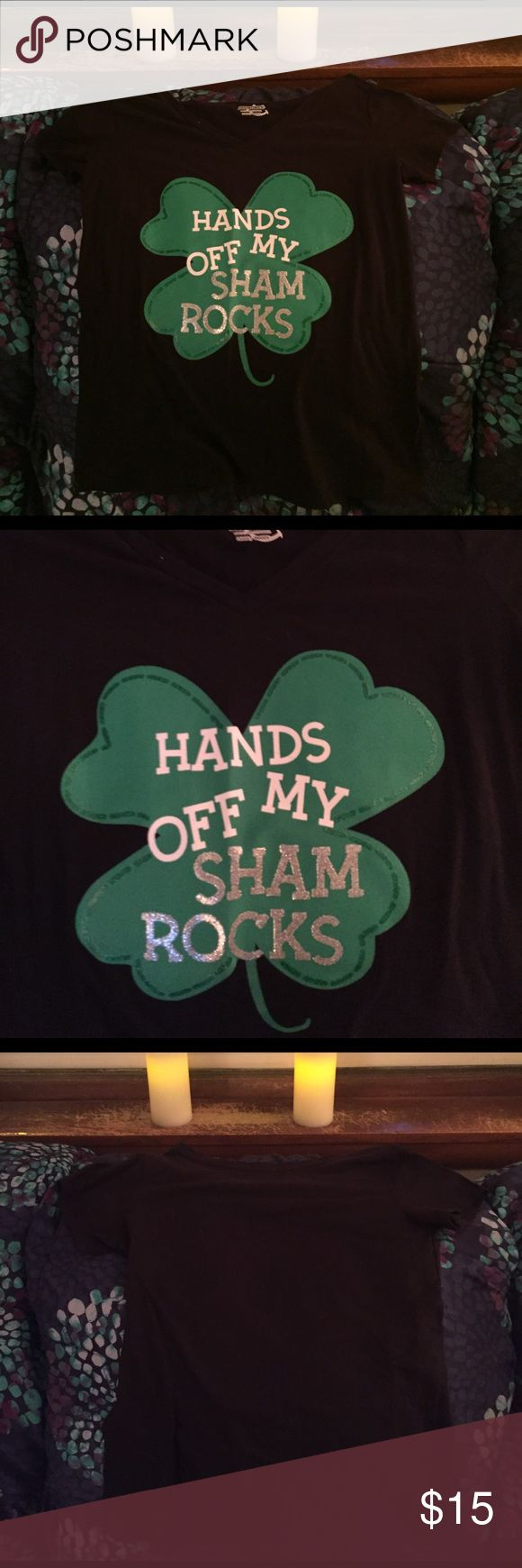 St Patrick's day t shirt Great big green four leaf clover with edges I. Green litter. White hands off lettering g. Silver glitter beautiful sham rocks lettering. Fits a size 8 in misses, snug but not uncomfortable for a 10. I eat a 19 in tops. Celebrate march 17 in style. Most party's will be on 15th and 16th.  Celebrate. NWOT Tops Tees - Short Sleeve