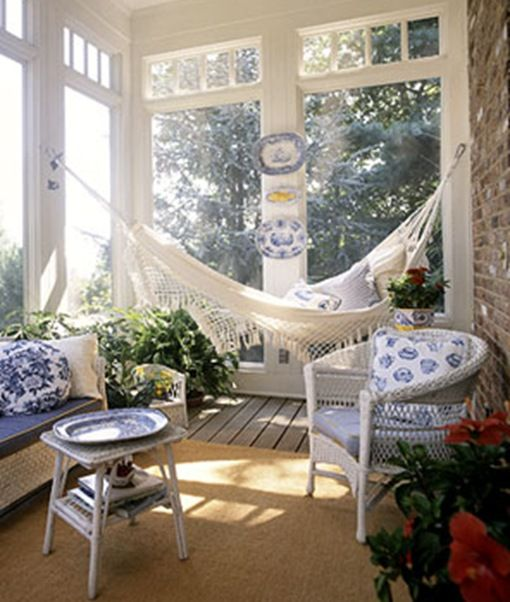 Blue and white plates decorate a porch. Photo by Dean Dixon for Ladies Home Journal.