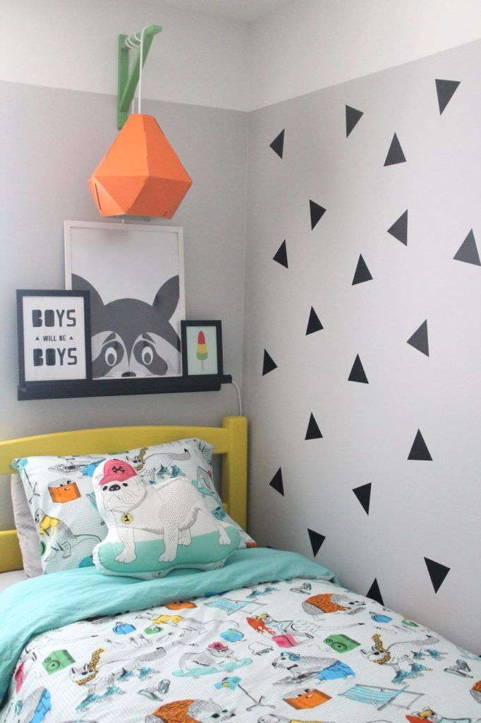 bright and geometric little boys shared bedroom