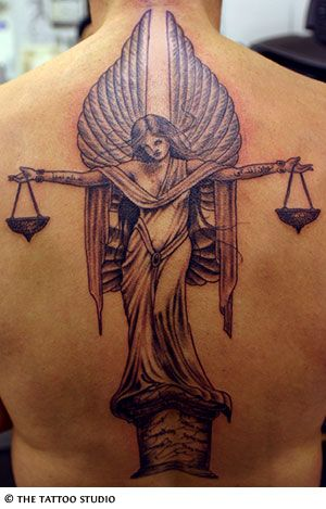 Libra Tattoo...I would NEVER but I like it and it's REALLY cool