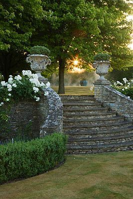 Gorgeous stone steps flanked by a lovely garden