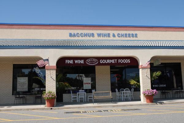 Bacchus Wine & Cheese Monteray Plaza - South Side of the Food Lion  891 Albacore Street, Corolla, NC, US 27927 (252) 453-4333 Enjoy your gourmet sandwich, salad, or sub with your best friend in the sidewalk cafe, artisan cheeses. A great place to relax and enjoy good food and great furry friends!  About 6-7 outdoor tables are dog friendly. Sandwiches were very good and staff friendly. Not much atmosphere as you overlook parking lot.  http://www.bringfido.com/restaurant/9552/