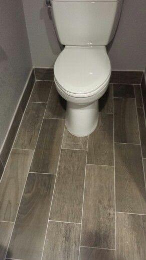 Gray tile. Love the tile baseboard