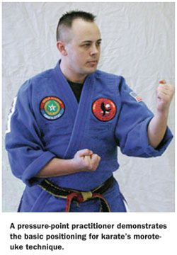 A kyusho-jitsu practitioner gets ready to execute self-defense moves using human pressure points.