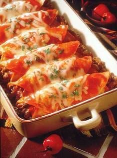 Homestyle Beef Enchiladas - Homestyle Beef Enchiladas        Ingredients:  1 lb. lean ground beef  ½ cup chopped onion  2 cloves garlic, crushed  ½ tsp salt  ¼ tsp pepper  2 10 oz cans enchilada sauce *  8 small corn tortillas (6-7 inches diameter)  ¾ cup shredded Monterey Jack or Cheddar cheese  1 Tbsp chopped fresh cilantro  sour cream (optional.