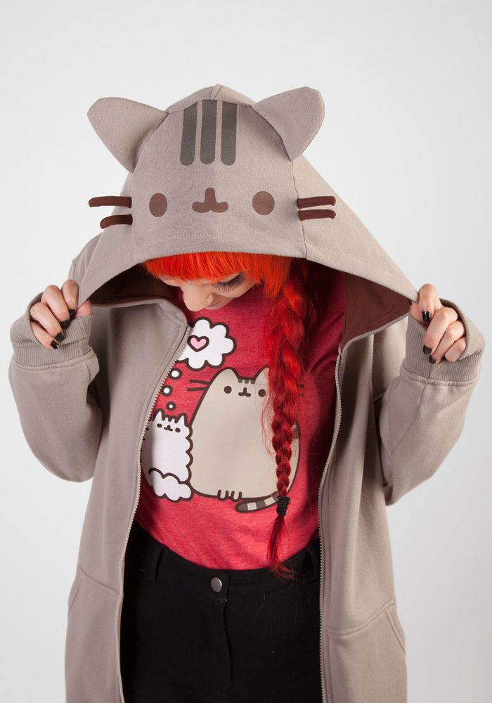 Love Pusheen so much you want to be Pusheen!? This unisex hoodie features a hood with a contrasting inner brown lining and Pusheen's face, ears and whiskers on the exterior. Additionally, Pusheen's st