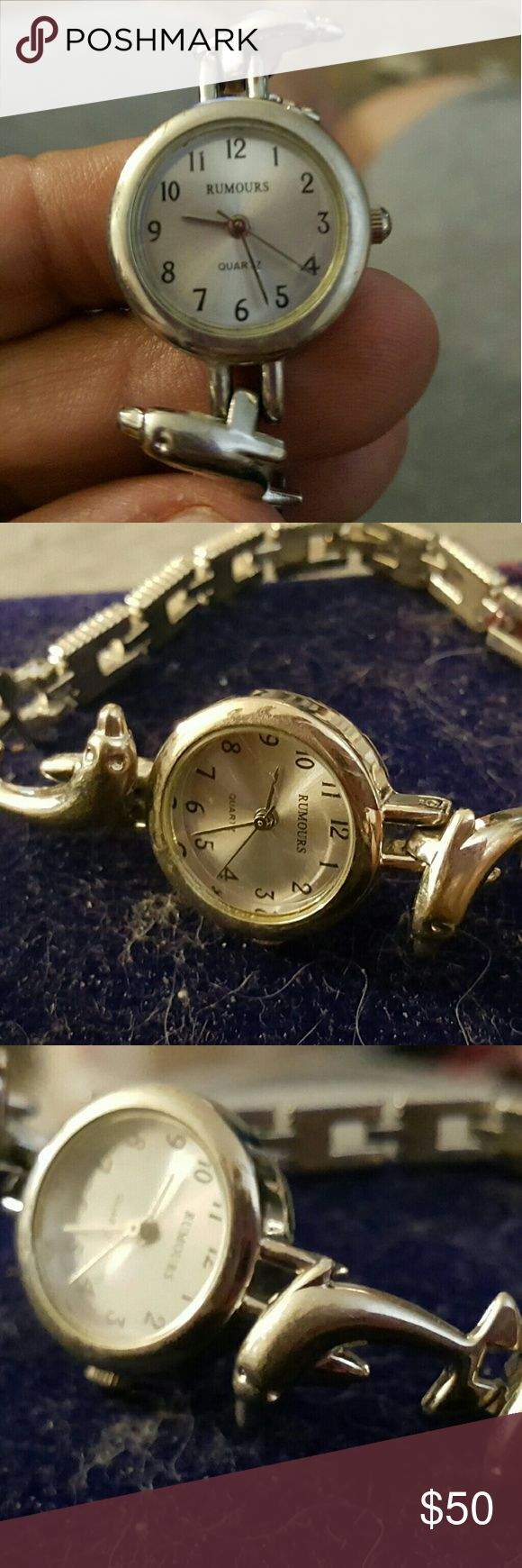 ??SPRING SALE ?RUMOURS SILVER  DOLPHINS WATCH Very nice delicate womens watch with dolphines on band silver very beautiful to have works great 7in rd Rumoure Accessories Watches