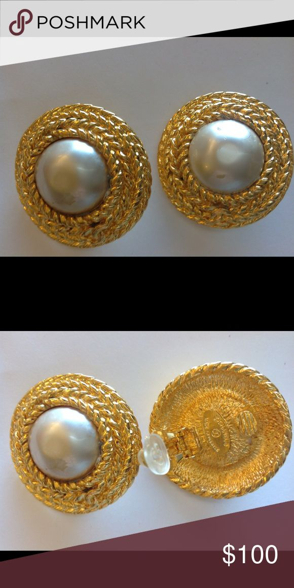 Vintage Chanel Earrings They measure 1 1/2 inches across.  There is light tarnishing on earrings and one of the faux pearls is peeling a little.  They are clip ons. Therefore I am offering them for a great price. CHANEL Jewelry Earrings