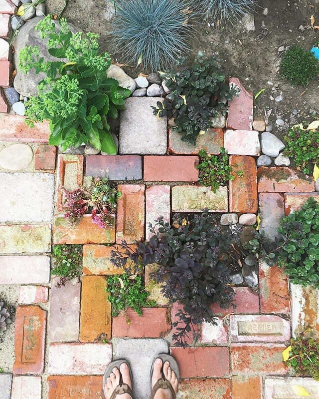 The inspiring pins in my Garden Fantasy Pinterest board are coming true! Here are some of the reclaimed bricks that we put down in the backyard.