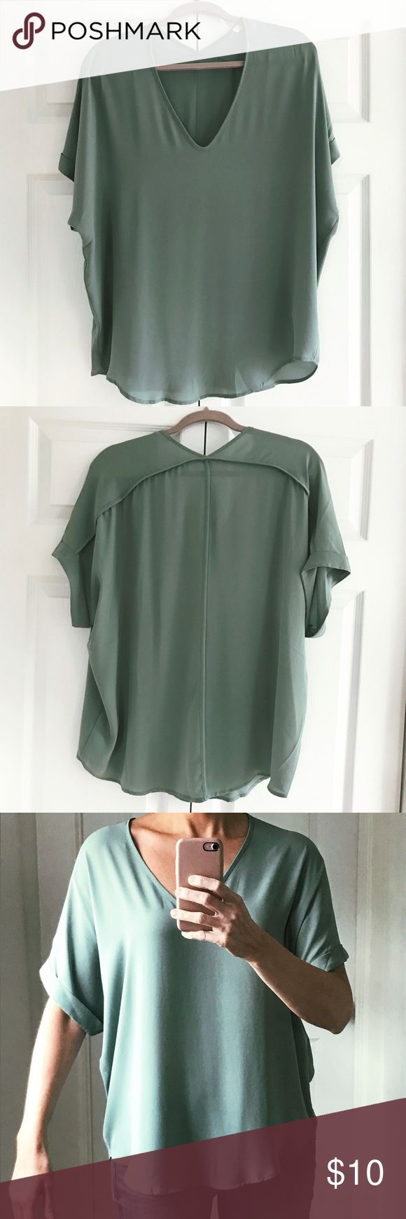 "Short sleeve blouse Lightweight, short sleeve green blouse by Lush. Size Large. Rounded/curved hem. Flowy fabric is comfortable and camouflages the tummy, muffin top and/or hips. Worn one time; in perfect condition. Color is a light sage green. Will fit L/XL. For reference, I'm 5'8"", 143 lbs and usually wear a 6/M. Lush Tops Blouses"
