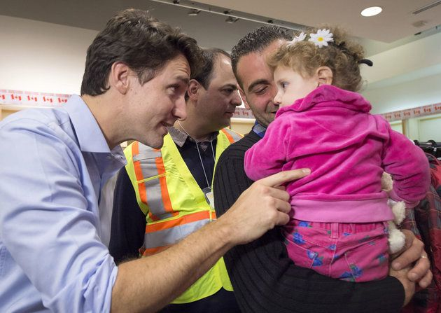 Justin Trudeau Welcomes Syrian Refugees To Canada With Open Arms