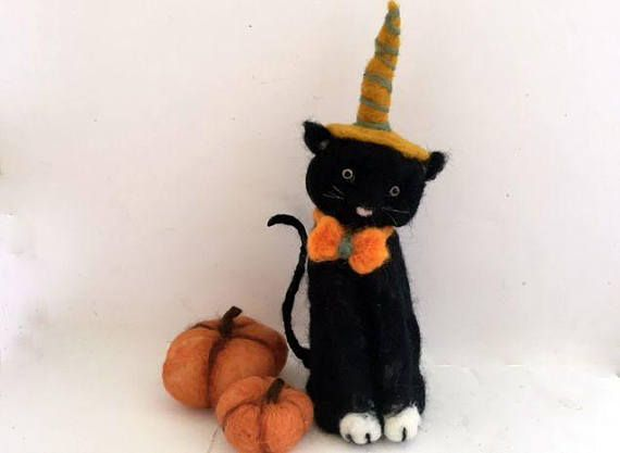 Needle felted black cat over a wire armature with needle felted pumpkins. Perfect addition for Halloween decoration or table centerpiece.  I believe cats to be spirits come to earth. A cat, I am sure, could walk on a cloud without coming through. ...quote by Jules Verne  This felt cat is made using a dry needle felting technique over a wire armature. The materials used are white and black blended mohair wool roving. His eyes are light amber glass and glued in place. This animal can be posed…
