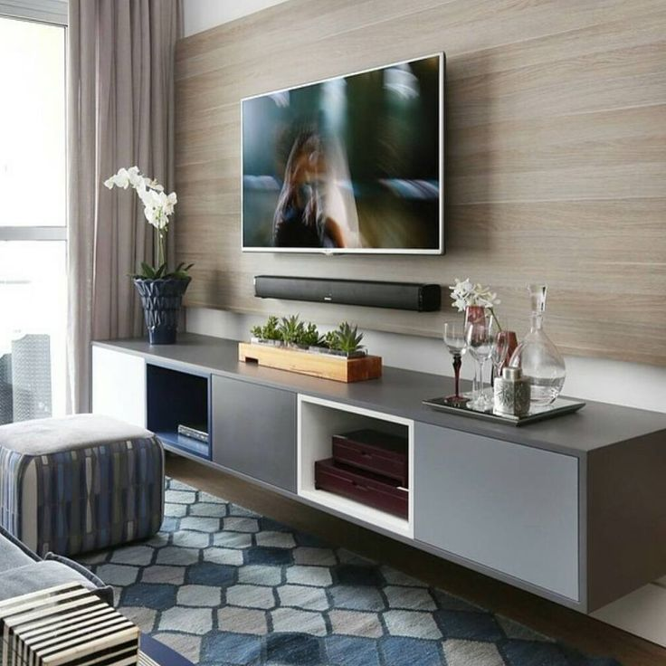 TV with paneling and stereo below