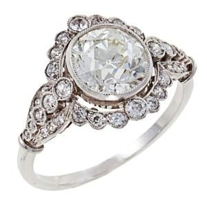 Edwardian Diamond Platinum Ring, circa 1915. This beautiful, delicate ring centers 1 old European-cut diamond, 2.13 carats, I-J, SI1, (faces up whiter!) surrounded by 36 old European-cut diamonds, total weight is approximately .43 carats, H-I, VS2-SI2. How pretty is this one? by Metta Nichole