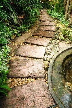 Stepping Stones with leaf designs along a garden path.