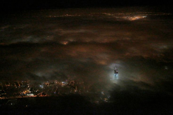 By Matthew Ziegler—AP  March 12, 2013. One World Trade Center emerges from the clouds in the night sky in a photo made from a passing airplane in New York.