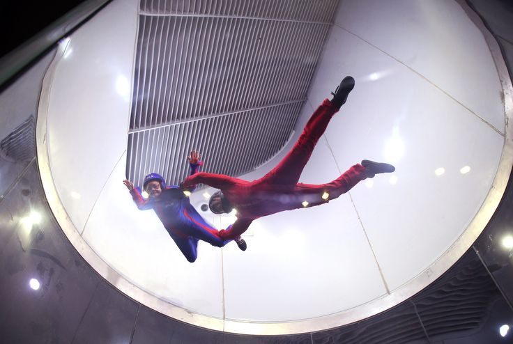 rances-Morgan Lewis, 10, of Chicago, gets airborne assistance from instructor Miguel Roa at iFly in Lincoln Park. The facility is the first indoor skydiving location in Chicago. (Phil Velasquez / Chicago Tribune)