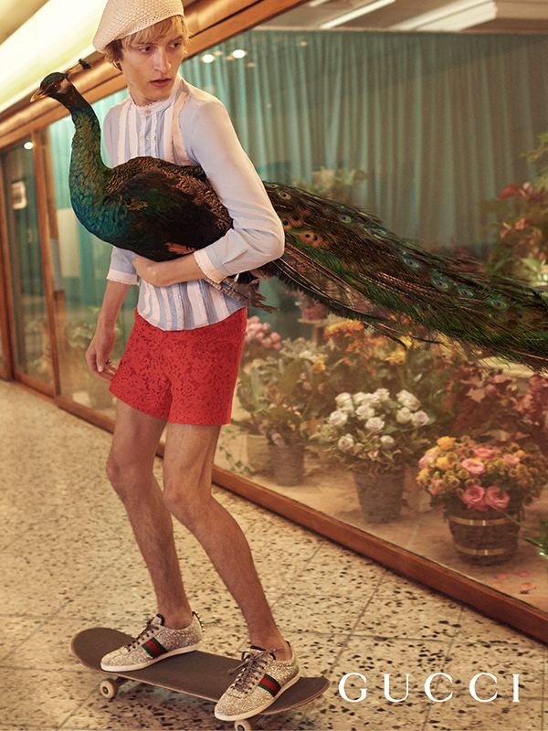 Berlin's urban setting is the backdrop of the Gucci Spring Summer 2016 collections by Alessandro Michele in the new campaign by Glen Luchford. Model Tim Dibble in lace shorts, shirt, a cotton beret, and silver Web sneakers.