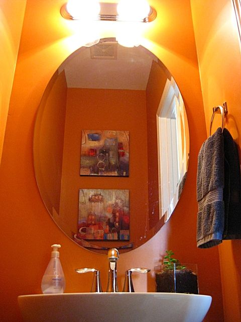 Small Windowless Bathroom?  Use a bright color to add chi.    Maybe coral?