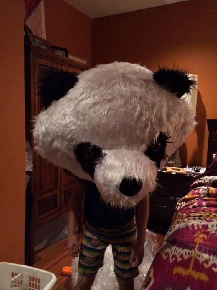 Boy wearing a panda head