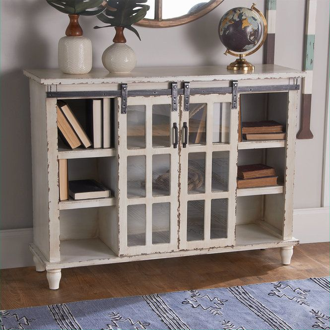 This Gently Distressed Console Table Has Ample Shelving Space Perfect For Storing Books And Decretive D Resin Patio Furniture Furniture Unique Furniture Pieces Console table with glass doors