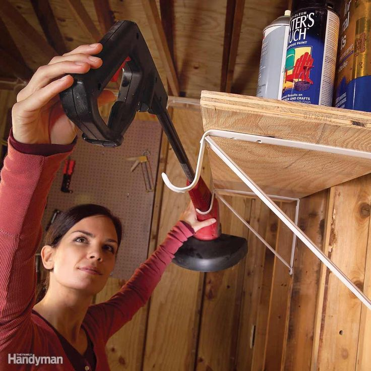 Shelf brackets designed to support clothes hanger rods aren't just for closets. The rod-holding hook on these brackets comes in handy in the garage and workshop too. You can bend the hook to suit long tools or cords. Closet brackets are available at home centers and hardware stores.