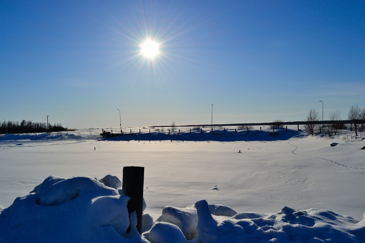 visited a frozen fishing wharf in Oulu, Finland