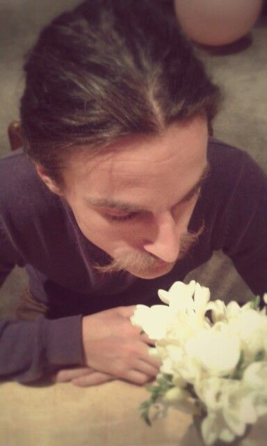 Flowers stare at man