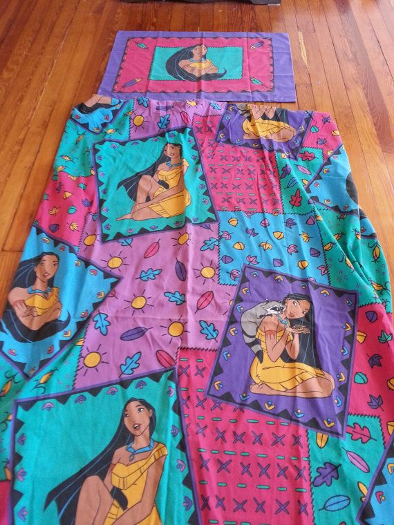 oh wow these bring back memories I used to love Pocahonta's back in the day and I had my whole full room of this stuff Pocahontas's bedding set and window certin's the whole set that went with this  <3 anyone ever had this back in the 90's too?