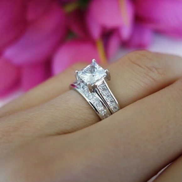 Stainless Steel Princess Cut wedding Set Stunning!! This beautiful Princess cut is set in 316L Jewelers grade of stainless steel, it will never turn or tarnish. The cubic zirconium  are AAA+. This is a beautiful set!! Looks as  Jewelry