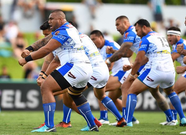 Samoan players led by Canberra Raiders Junior Paulo do the 'Siva Tau' Cultural Challenge before the start  the 2017 Rugby League World Cup match between Samoa and Scotland at Barlow Park on November 11, 2017 in Cairns, Australia.