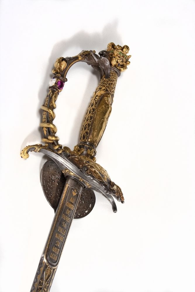 Masterpiece of a goldsmith in Paris, this sword, performed under the direction of Froment-Meurice, was donated by the municipality Count of Paris, son of the Duke of Orleans, on the occasion of his baptism, celebrated May 2, 1841 at Notre Dame.