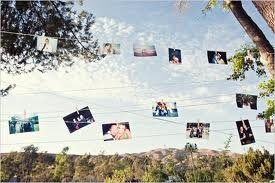 If the area does not have trees to wrap the pictures around stringing them from one place to another is a good idea