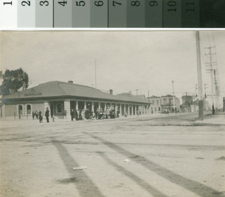 "Original from an album of snapshots of scenes in Oakland made by Horace E. Smith in 1913. On back of item: ""p. 13"". The station depicted was demolished to accomodate construction of the Jack London Inn on the east side of Broadway at Embarcadero, formerly First St. The station served passengers on the Transcontinental Railroad."