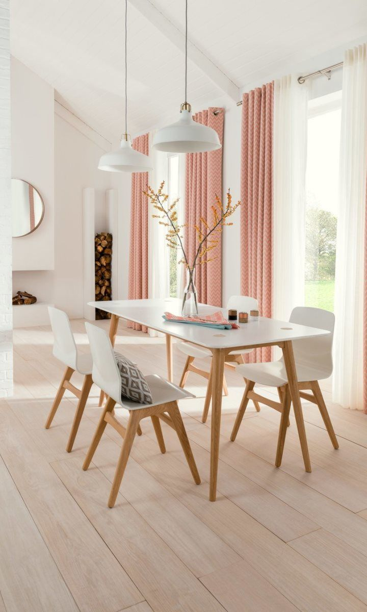 White and natural wood shades create the perfect Scandi theme, pair this with bright pops of colour is soft furnishings such as Horizon Salmon made to measure Curtains add a lovely finishing touch.