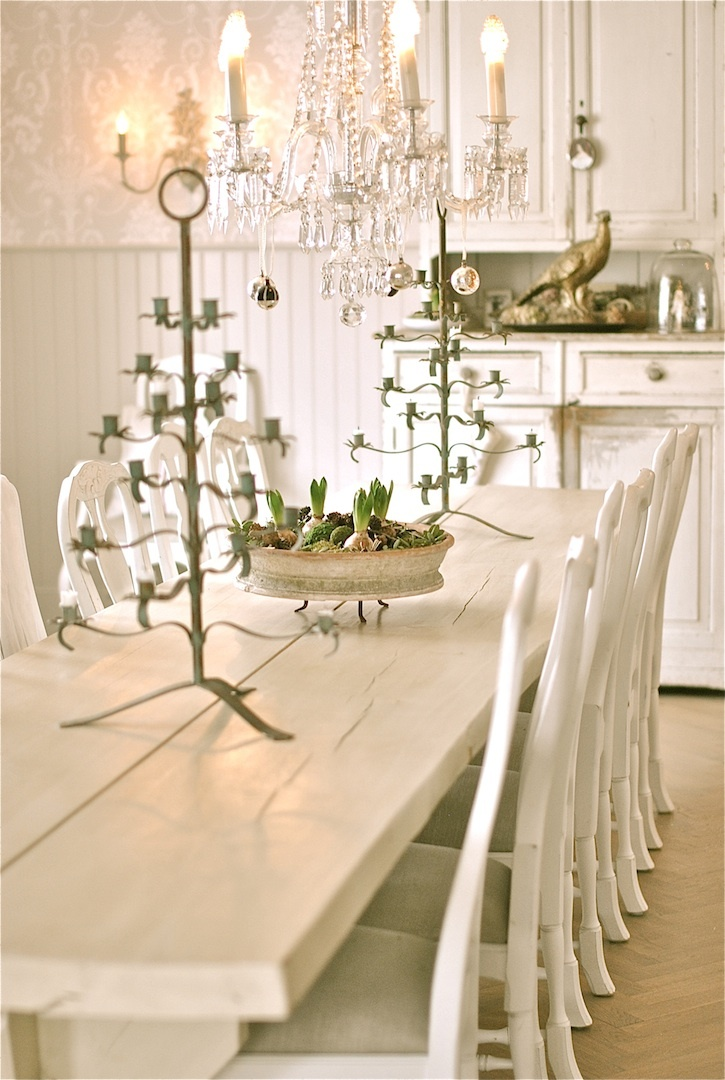 I like the candle holders in a lovely dining room-Swedish/Scandinavian interior design.