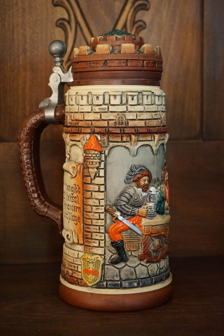 Here's a rare Original Thewalt Castle Stein that has a mix of gloss and flat finishes to make a unique item that would be a great gift for any stein collector. This piece is signed on the bottom by Me