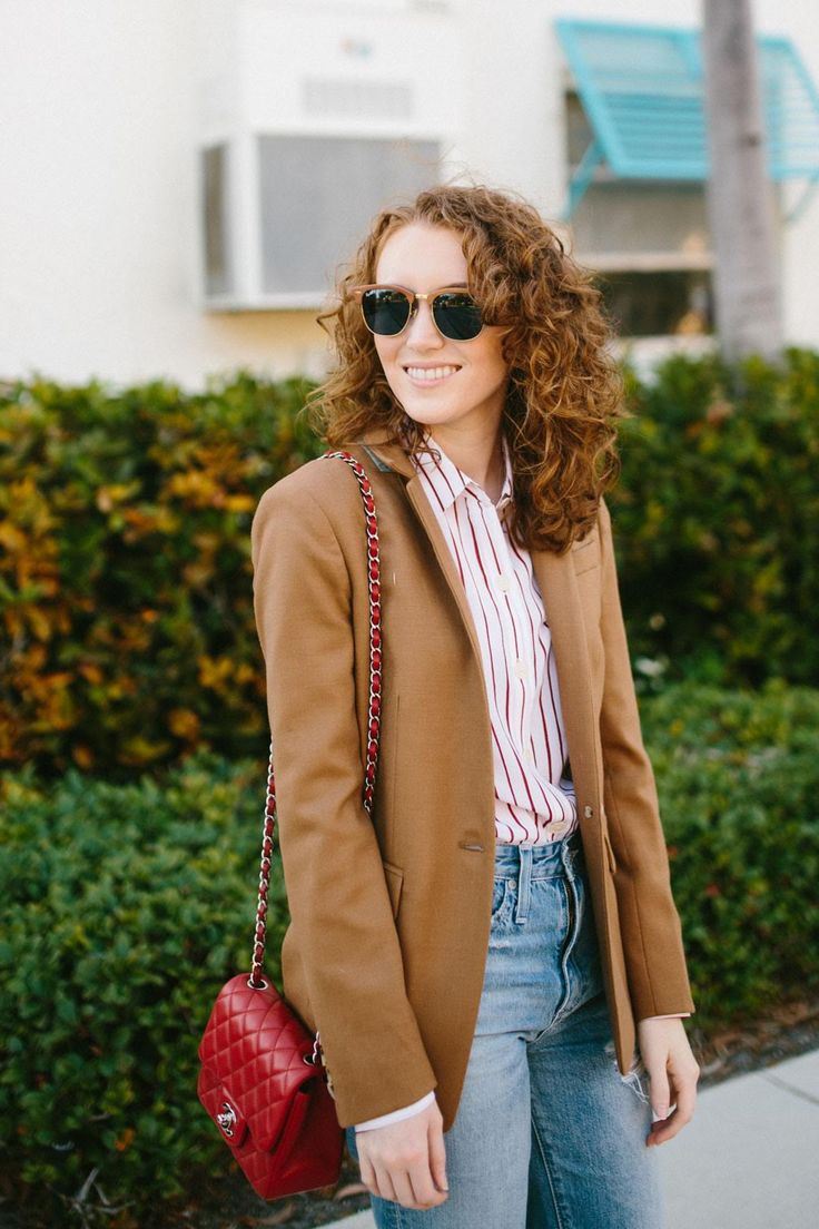 Brown blazer with jeans and matching brown sunglasses