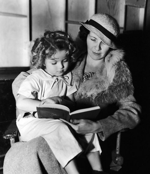 Shirley Temple reads a book with her mother Gertrude, 1934. Timely.