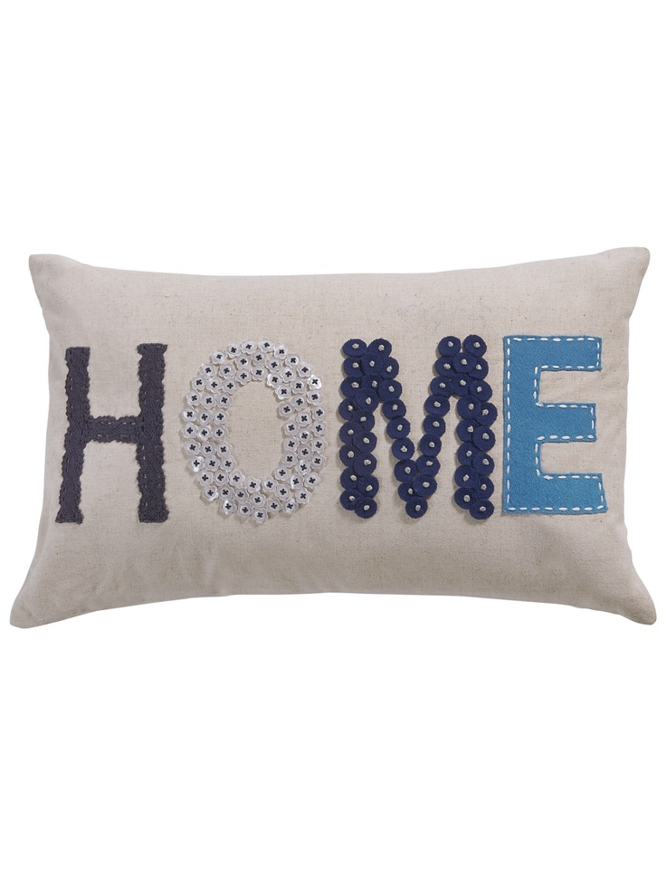 Just had an idea to sew buttons to make words on a pillow. hmm