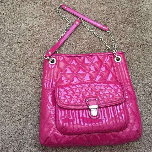 Pink Coach purse One small tear on back bottom as shown in pic. Other than that it's in great condition. Love this bag! Coach Bags