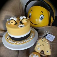 What will they bee? Cupcake tower for a twin baby shower. With Matching Bee hive cookies.