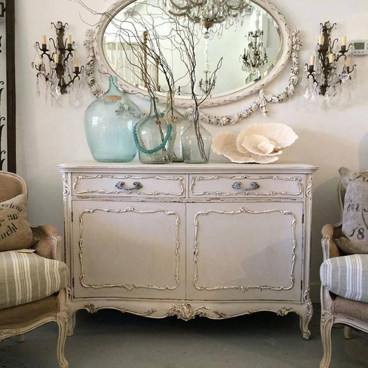 Elegant French Country buffet with mirror and accessories!  I love all the colored transparent jugs!