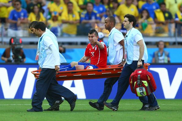 Gary Medel of Chile reacts while being stretchered off in extra time during the 2014 FIFA World Cup Brazil round of 16 match between Brazil and Chile at Estadio Mineirao on June 28, 2014 in Belo Horizonte, Brazil.
