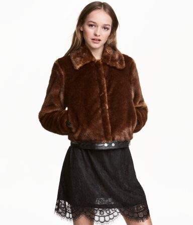 Check this out! Short jacket in soft faux fur with imitation leather details. Large collar, concealed snap fasteners at front, and side pockets. Imitation leather trim at cuffs and hem. Lined. - Visit hm.com to see more.