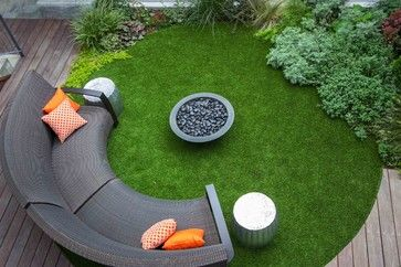 The ipe deck surrounds a lawn and a gas fire pit. To minimize maintenance, Jones chose XGrass Luxury Pro artificial turf from ProGreen. Unlike the synthetic grass of old, he says, today's products look remarkably natural and feel soft underfoot. Drainage below the lawn takes care of rain.
