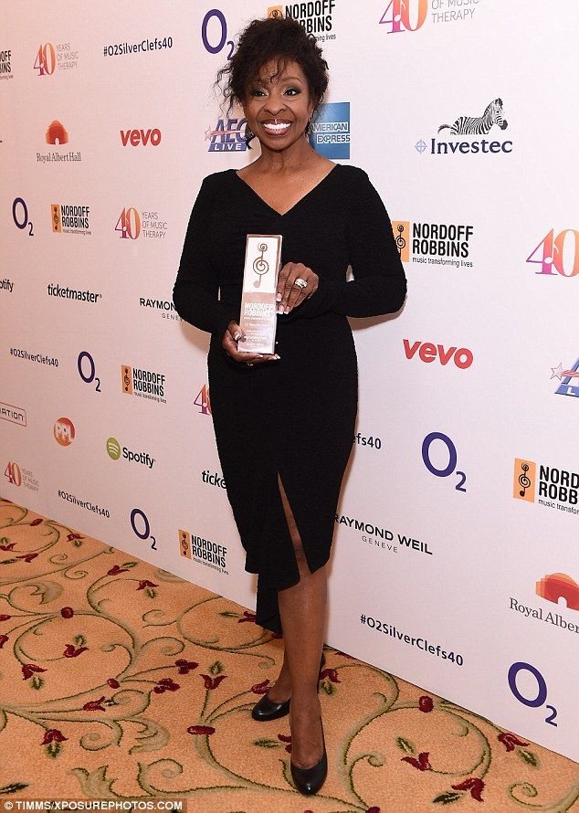 Hard-earned prize: Singer Gladys Knight was thrilled as she held aloft her Raymond Weil In...