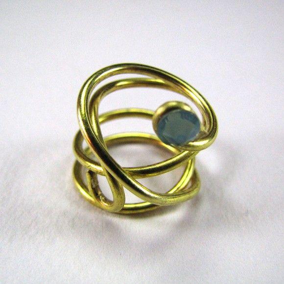 Handmade fingertip ring made of brass wire with an ocean blue zwarovski stone.